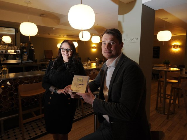 Hospitality Manager Phil Lockwood and Restaurant manager Vikki Humble pictured with the Street Smart award at the 4th floor Restaurant, Harvey Nichols.