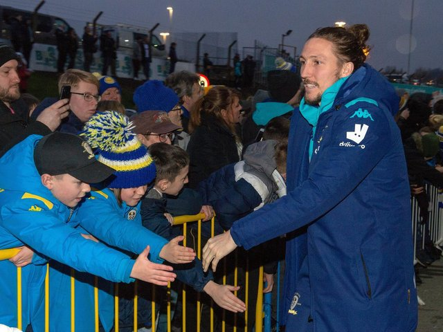 'STICK WITH US': Defender Luke Ayling with some of Leeds United's travelling fans at October's clash at Preston North End.