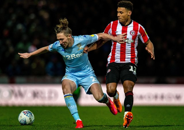 WILY CAMPAIGNER: Luke Ayling holds off Brentford's Ollie Watkins. Picture: Bruce Rollinson.