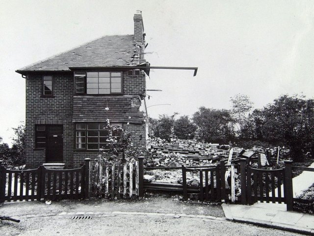 A semi-detached house is levelled by bombing in 1941 with just its guttering surviving.