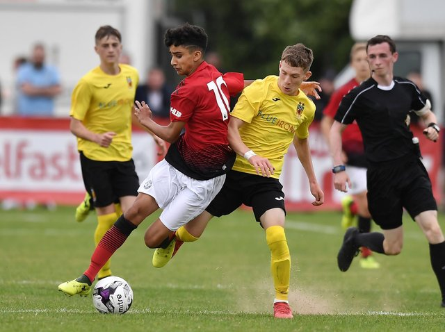 WANTED MAN: Leeds United target and Linfield youngster Charlie Allen, playing for County Antrim in the SuperCupNI Junior section final against Zidane Iqbal of Manchester United. Pic: Getty