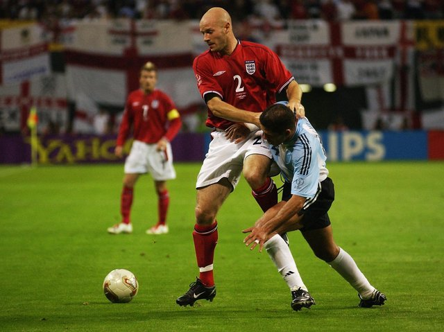 STRONG: Leeds United and England full-back Danny Mills holds off Argentina's Diego Simeone during the 2002 World Cup clash. Photo by Stu Forster/Getty Images.
