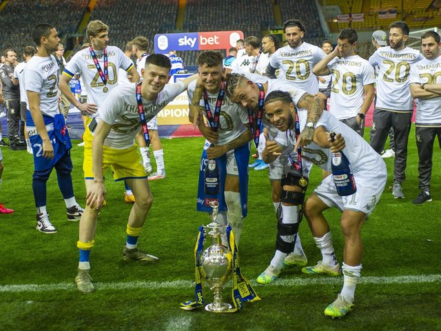 Leeds United's Tyler Roberts (R) celebrates with the Championship trophy alongside Kalvin Phillips, Ben White and Illan Meslier. (Tony Johnson)