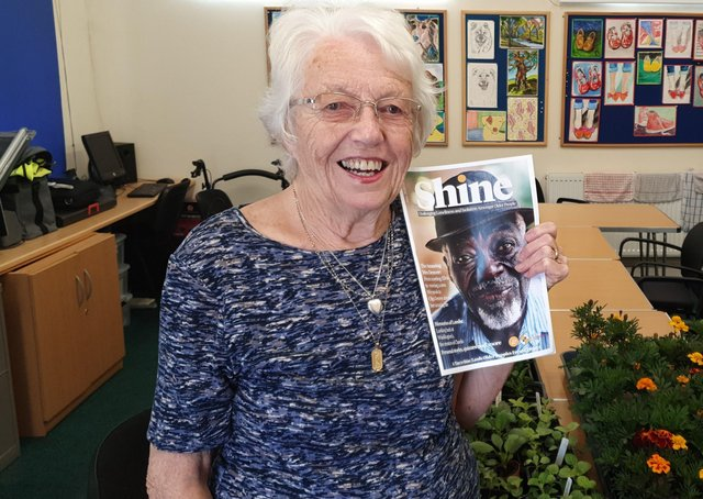 Joan Bennet with her copy of Shine magazine which has helped older people in Leeds feel connected during lockdown.