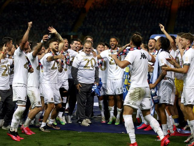 IN CONTROL: Head coach Marcelo Bielsa, centre, celebrates Leeds United's Championship title triumph surrounded by his jubilant players. Picture by Tim Goode/PA Wire.