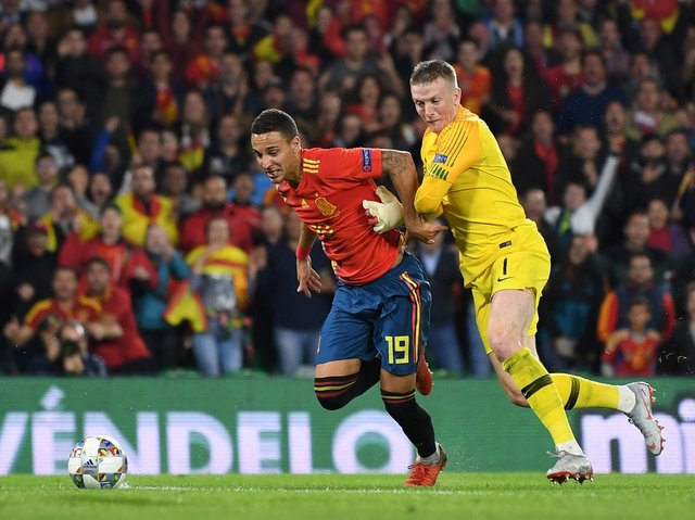 BIG GAME - Rodrigo has plenty of top level experience with Valencia and with the Spanish national team. Here he's competing for the ball with England keeper Jordan Pickford in a Nations League fixture. Pic: Getty