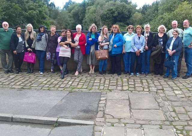 Armley Helping Hands' board of trustees, staff and volunteers are pictured taking a break from their busy routine on an away day.