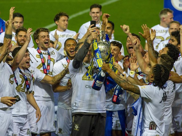 Leeds United head coach Marcelo Bielsa lifts the Championship trophy at Elland Road. (Tony Johnson)