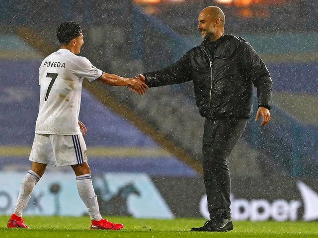TOUGH GAME - Ian Poveda shaking the hand of former manager Pep Guardiola after starring in Leeds United's 1-1 draw with Manchester City. Pic: Getty