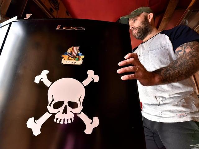Owner Keith Webster inside the caravan
