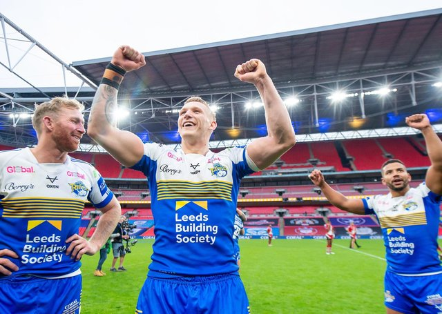 History-making Challenge Cup winner Mikolaj Oledzki (centre) has signed a new four-year contract with Leeds Rhinos. Picture: Allan McKenzie/SWpix.com.