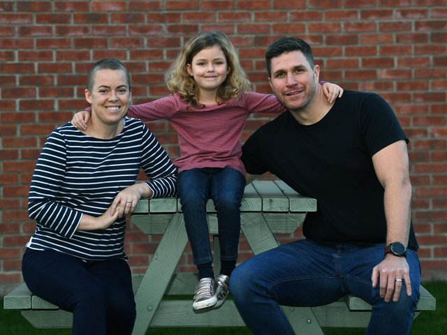 Cancer sufferer Tammi Morrel-Knapton, who started her policing career in Leeds, is fundraising to pay for a drug treatment she hopes will give her more precious time to make memories with her daughter. Pictured with her daughter Isabella and husband Nick. Picture : Jonathan Gawthorpe