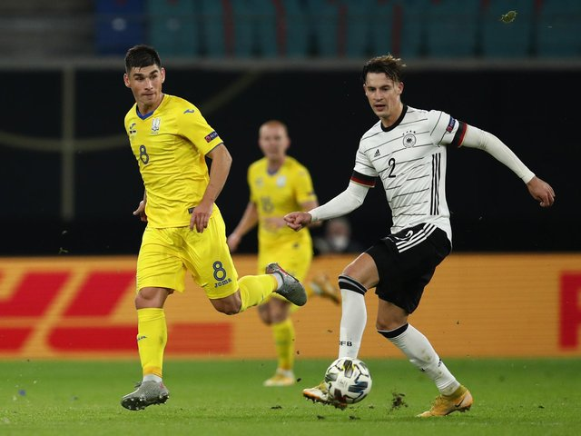 'GOOD JOB': From Leeds United's Robin Koch, right, pictured controlling the ball ahead of Ruslan Malinovskyi during Saturday evening's 3-1 victory against UEFA Nations League visitors Ukraine. Photo by Maja Hitij/Getty Images.