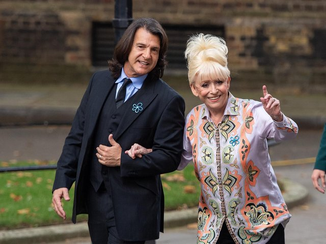 Dame Barbara Windsor and her husband Scott Mitchell arriving to deliver an Alzheimer's Society open letter to 10 Downing Street (Image: PA Wire/Dominic Lipinski)