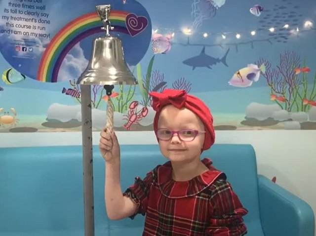A young patient rings a bell to mark the end of her treatment at the end of the video (photo: still taken from Leeds Teaching Hospitals Christmas video)