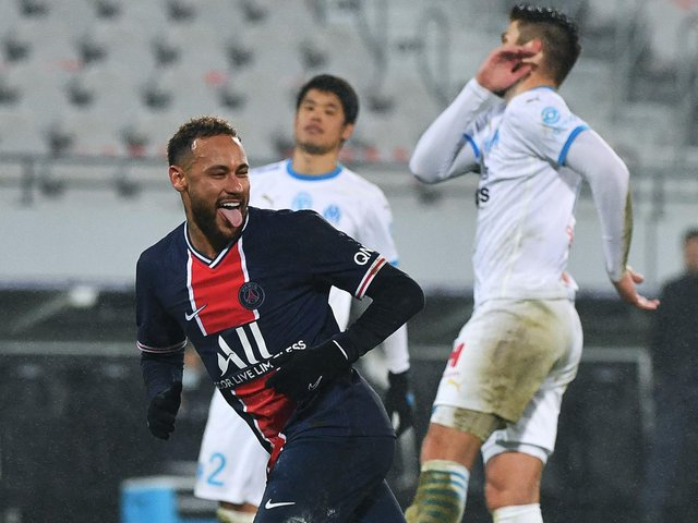'GALACTICO': Paris Saint-Germain's Brazilian forward Neymar celebrates after scoring from the penalty spot during the Trophee des Champions match against Marseille. Photo by DENIS CHARLET/AFP via Getty Images.