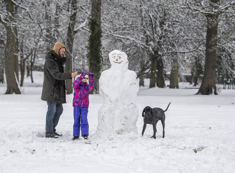 Noa Acaster Clarke and her dad, Aiden, built a snowman in Horsforth Hall Park