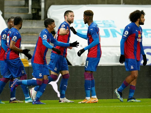 MAJOR BLOW - Crystal Palace star Wilfried Zaha, pictured celebrating Gary Cahill's goal against Newcastle United, will certainly miss the visit to Leeds United on Monday. Pic: Getty