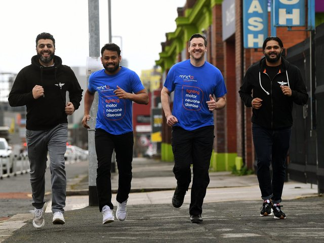 Members of the Akhirah Team, a humanitarian charity in Leeds which has organised a '7 for 7' running challenge for MND and Rob Burrow. From left, Aihtsham Rashid, Kabir Miah, Sgt Mark Rothery and Mo Ali. Picture: James Hardisty