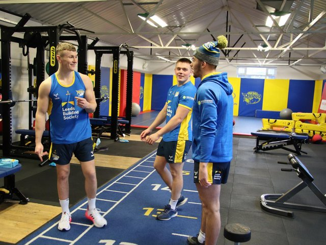 Harry Newman, left, in Rhinos' Kirkstall gym with teammate Callum McLelland and assistant-coach Chev Walker. Picture by Phil Daly/Leeds Rhinos.