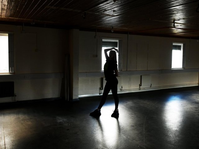 Kaci Emmonds, young dance leader, in the dance studio being refurbished at the Dazl  Dance Centre at Middleton Community Centre in Leeds.