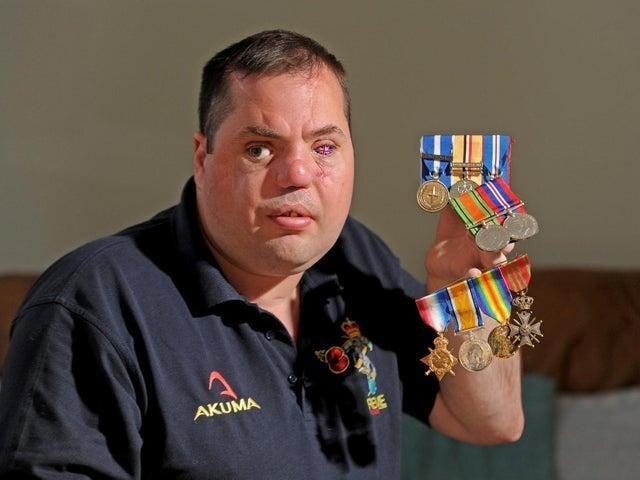 Simon Brown pictured with his own medals and those of his grandfather and great-grandfather who fought in both the World Wars in November 2019. Picture Tony Johnson.