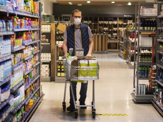 File photo of a shopper wearing a face mask in a supermarket.