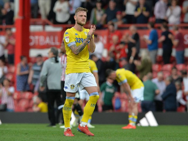 HEARTACHE: Whites captain Liam Cooper applauds the travelling Leeds United supporters following the 2-0 defeat at Brentford of Easter Monday 2019. But Leeds romped to promotion as champions one year on. Picture by Bruce Rollinson.