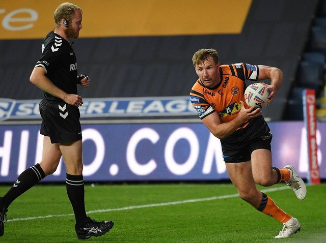 Michael Shenton scores against Salford last season as referee Robert Hicks watches on. Picture by Jonathan Gawthorpe.
