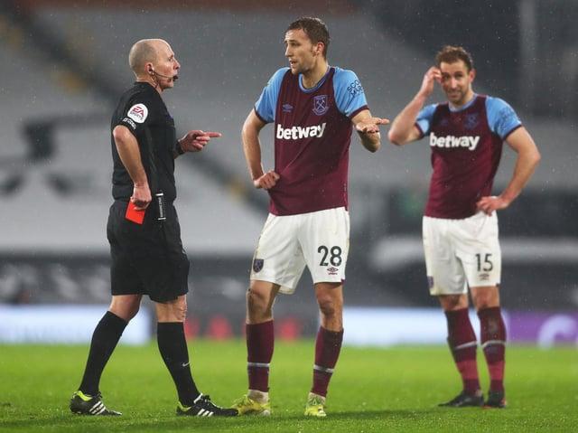 Premier League referee Mike Dean sends off West Ham defender Tomas Soucek. Pic: Getty