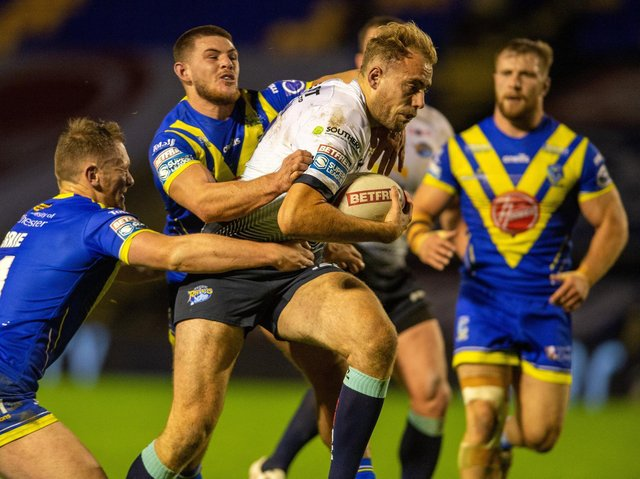 James Harrison carries the ball for Rhinos against Warrington last season. Picture by Bruce Rollinson.