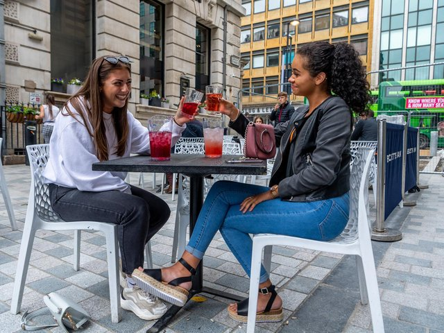 Two women enjoying a drink in the Becketts Bank Wetherspoon beer garden in summer 2020.