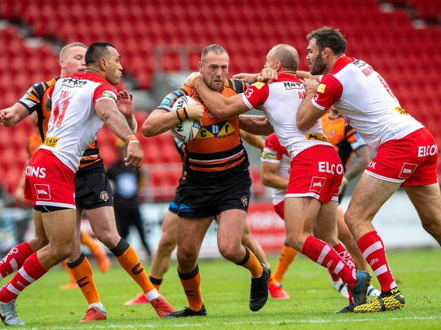 Liam Watts battles the St Helens defence. Picture by Jonathan Gawthorpe.