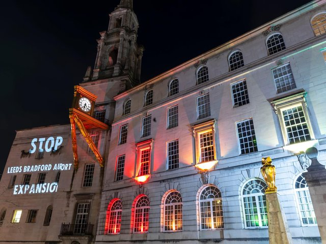 An anti-airport expansion message projected onto Leeds Civic Hall.