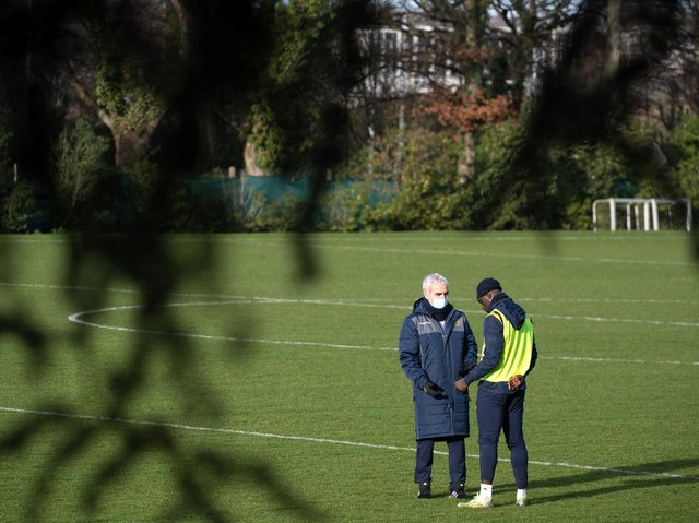 PHYSICAL STRUGGLE - Jean-Kevin Augustin, pictured with Nantes boss Raymond Domenech, has been suffering from 'long Covid' say his club. Pic: Getty