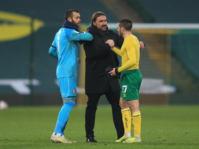 FLYING: Norwich City boss Daniel Farke with David Raya, left, and Emi Buendia, right, after Wednesday night's 2-0 victory at home to second-placed Brentford which put his leaders ten points clear. Photo by Stephen Pond/Getty Images.