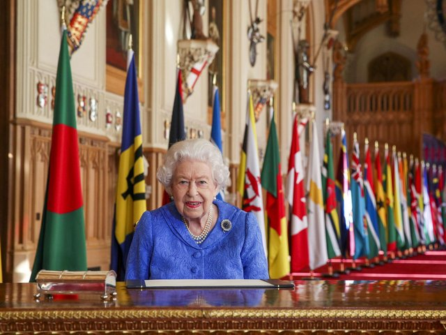 Queen Elizabeth II signs her annual Commonwealth Day Message in St George's Hall at Windsor Castle.