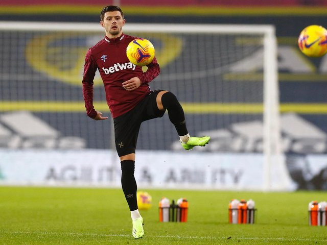 BRAZILIAN BATTLE: For West Ham full-back Aaron Cresswell, pictured warming up before December's Premier League clash facing Leeds United and Raphinha at Elland Road. Photo by JASON CAIRNDUFF/POOL/AFP via Getty Images.