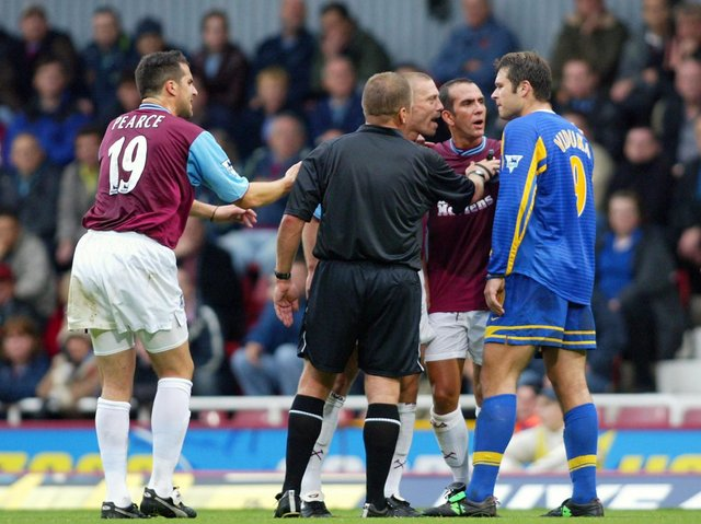 HEATED: Leeds United striker Mark Viduka, right, argues with West Ham's Tomas Repka, third from left, as Ian Pearce and Paolo Di Canio also become involved in the seven-goal epic of November 2003. Photo By Ben Radford/Getty Images.