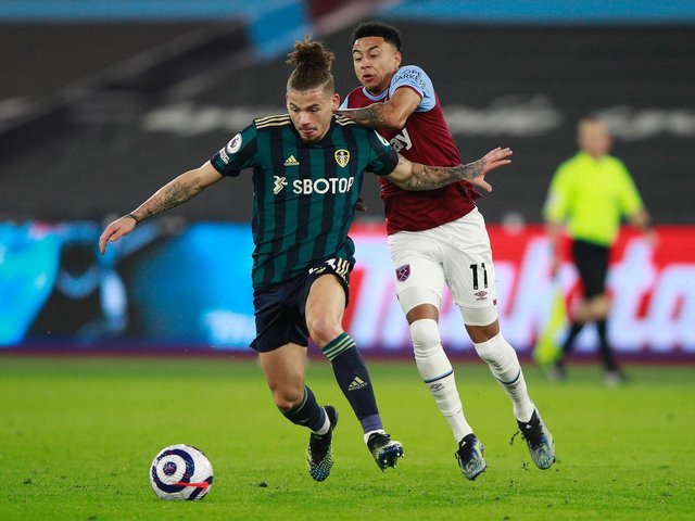 BACK TO IT: Leeds United's England international midfielder Kalvin Phillips, front, holds off West Ham's Jesse Lingard in Monday night's Premier League clash at the London Stadium. Photo by Ian Walton - Pool/Getty Images.