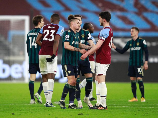 WINNING UGLY: West Ham captain Declan Rice with Leeds United's fellow England international midfielder Kalvin Phillips after Monday's Premier League clash at the London Stadium. Photo by Ian Walton - Pool/Getty Images.