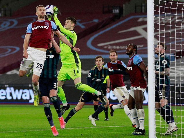 THREAT: West Ham bombard Leeds United with another set piece in Monday night's clash at the London Stadium as 'keeper Illan Meslier collects under pressure from Tomas Soucek. Photo by IAN WALTON/POOL/AFP via Getty Images.