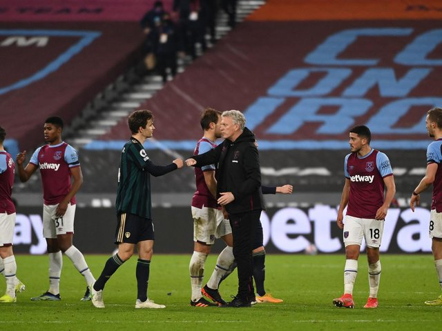 SETBACK: Leeds United's Spanish international defender Diego Llorente interacts with West Ham boss David Moyes after Monday night's 2-0 defeat at the London Stadium. Photo by Andy Rain - Pool/Getty Images.