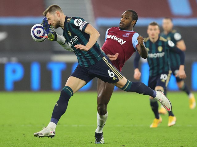 CAPITAL PUNISHMENT: Leeds United captain Liam Cooper challenges the high boot of West Ham striker Michail Antonio in Monday night's 2-0 defeat at the London Stadium. Photo by JULIAN FINNEY/POOL/AFP via Getty Images.
