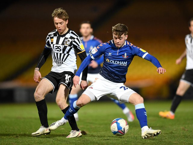 LEARNING LESSONS - Leeds United youngster Alfie McCalmont says he's learning how to take care of himself in physical games on loan at League Two Oldham Athletic. Pic: Getty