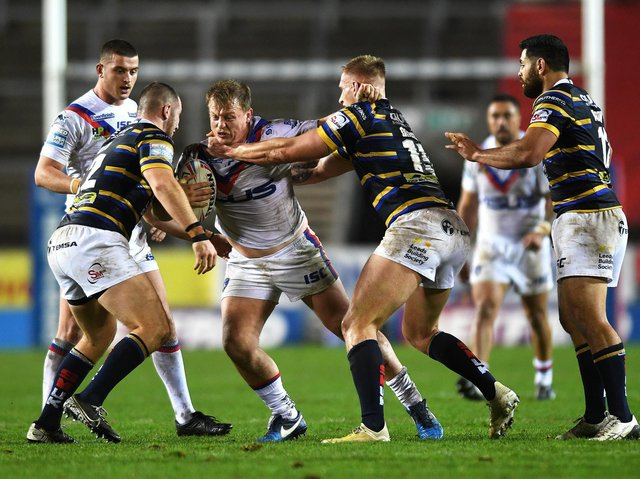 Eddie Battye, pictured on the attack against Leeds Rhinos, has a calf strain and is unlikely to feature this weekend. Picture by Jonathan Gawthorpe.