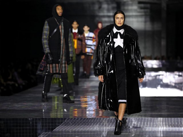Library image of Irina Shayk wearing a black leather coat during the Burberry London Fashion Week