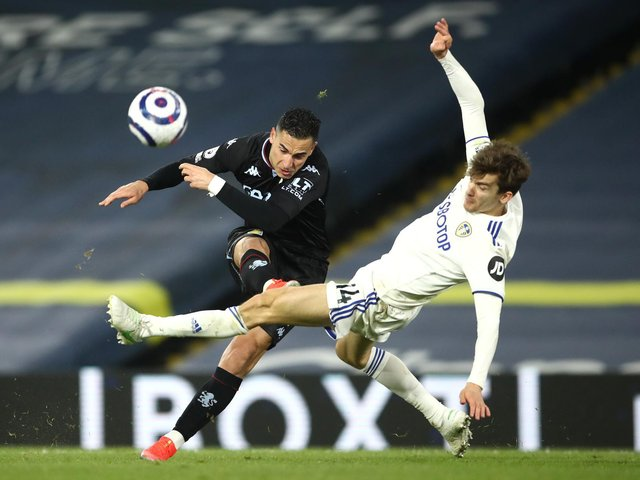 FLYING ALONG: Leeds United's Spanish international centre-back Diego Llorente, right, challenges striker Anwar El Ghazi during last weekend's 1-0 loss at home to Aston Villa. Photo by Tim Goode - Pool/Getty Images.
