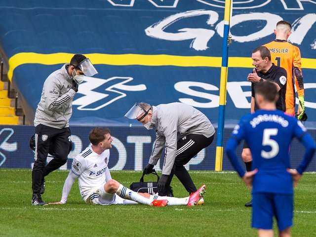 BLOW: Leeds United striker Patrick Bamford receives treatment before going off a few minutes later against Chelsea. Photo by Bruce Rollinson.