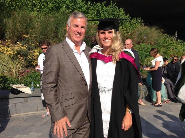 Bryony Turner, 29, with her late father Martyn at her graduation